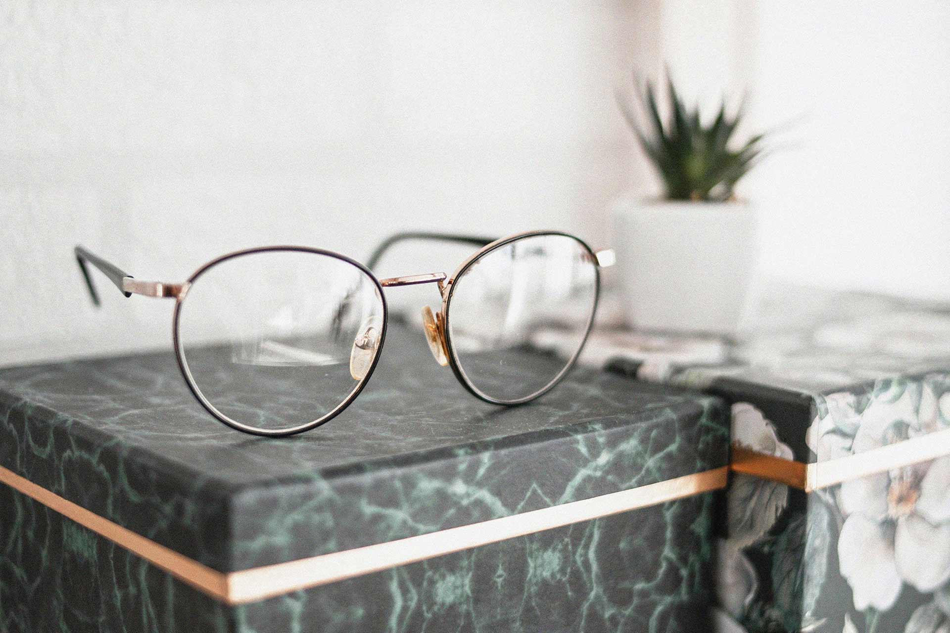 gray framed glasses in details grain photo