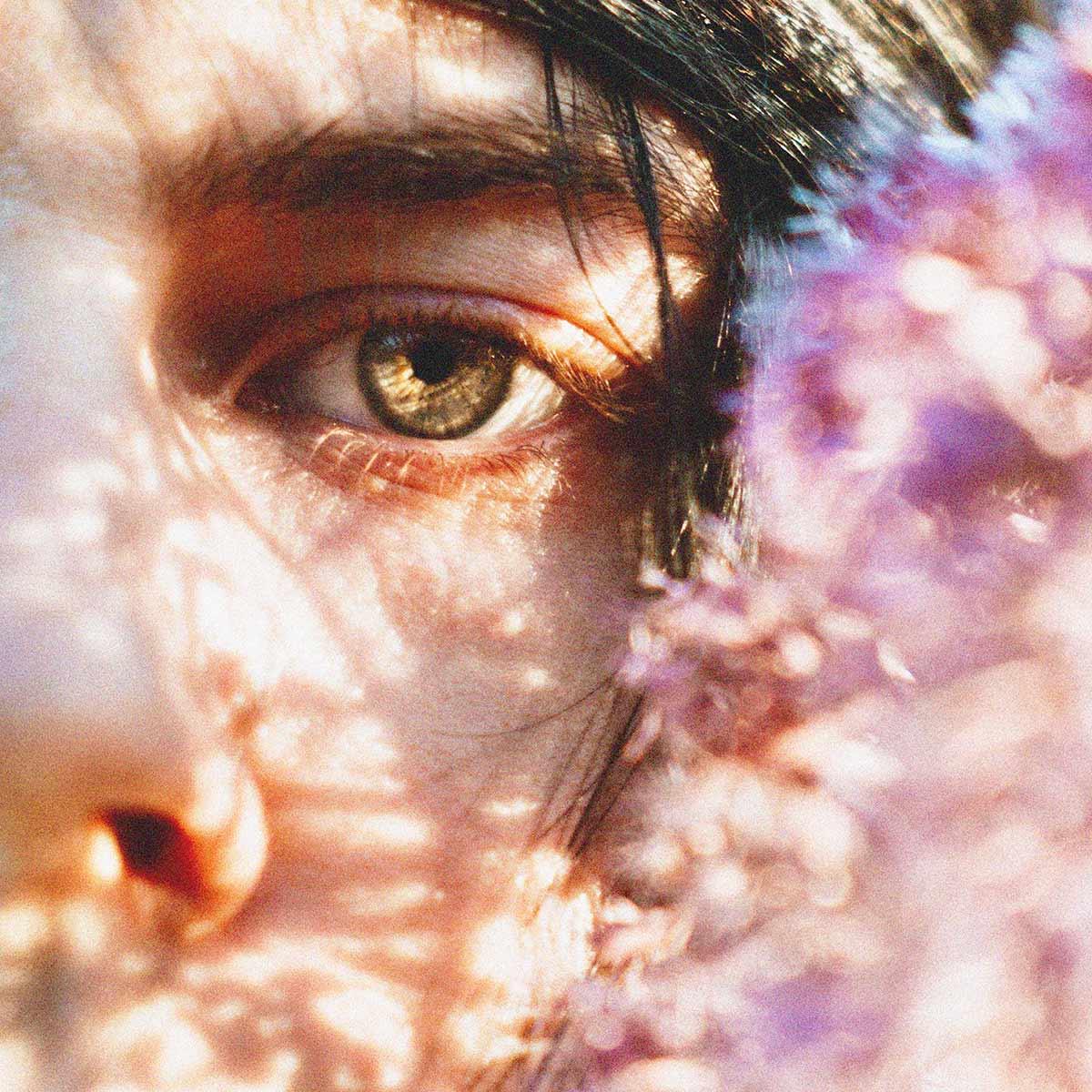 man green eyes in a zoom shot